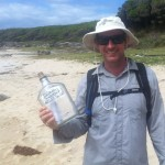 Ian Wells with the message in a bottle found by a Sydney Coast Walks' guest